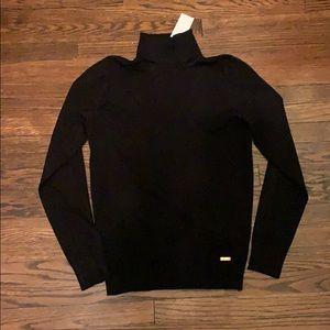Black Calvin Klein turtleneck sweater